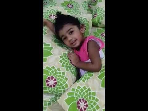 Cute 2 years old Indian girl singing rhymes.