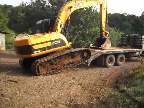 aprendam a embarcar uma escavadeira hidrauli