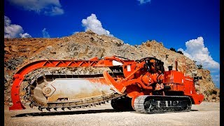 Trencher with disc and chain aggregates digs ditches and canals