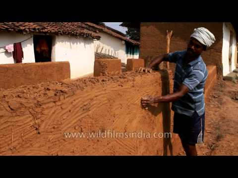 Mud house making at Gond tribal village in Narna, MP