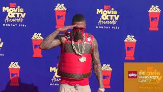 Nick Cannon at the MTV Movie & TV Awards with Bullet Proof Gucci Vest