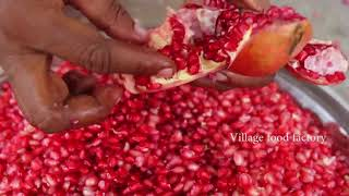 A MAN WHO CAN PEAL OF AND MAKE JUICE OF A POMEGRANATE VERY EASILY