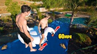 INSANE DIY HOMEMADE 60 MPH WATER SLIDE!! *WORLD RECORD*