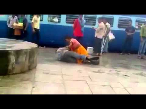 Indian women  beating guy at the railway station