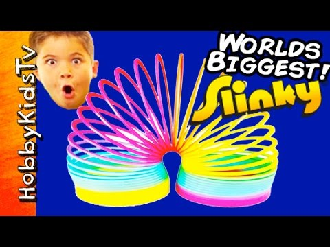 Worlds Biggest SLINKY Surprise Egg POOL Party Toys Puppy Robot Poop HobbyKidsTV