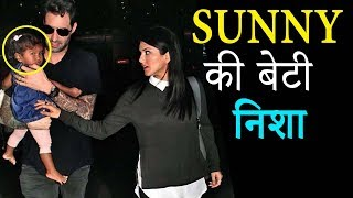 Sunny Leone Daughter Nisha Nestled in Daniel Weber Arms At Airport | 2017 | BMF