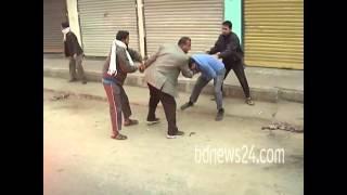 Bangladesh Police (DB) man is beaten during Jamaat strike in Barisal