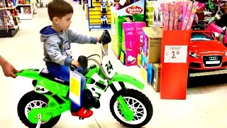 Little Boy Playing at Toys R Us Superstore Fun For Kids