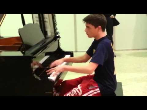 Master 12 yr. Old Pianist plays at mall.  Amazing!