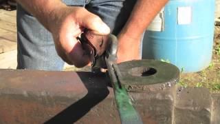 Blacksmith Hardening and Tempering a Horseshoe Knife