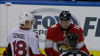 Dzingel and Smith laughing one second, in an intense fight the next