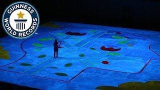 Largest UV blacklight painting- Guinness World Records Day 2018