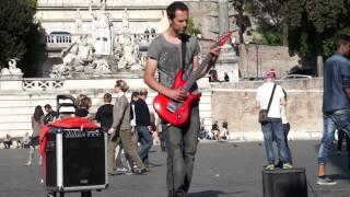 Street guitarist plays