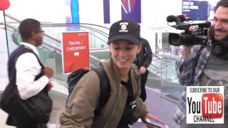 Julieanna Goddard aka YesJulz talks about her recent bikini photo shoot while departing at LAX Airpo