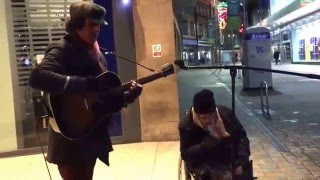 Homeless man joins busker for spontaneous New Year