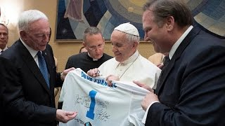 Pope Francis nearly tries on Cowboys helmet
