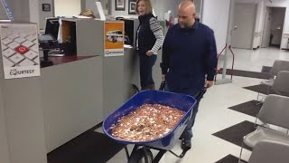 Man Pays Nearly $3,000 Bill Using A Wheelbarrow Full Of Pennies