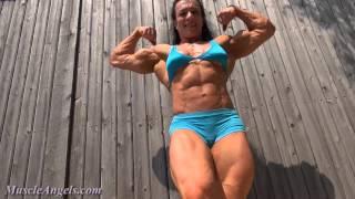 Maximum female muscle flexing:  Muscle Angels.com