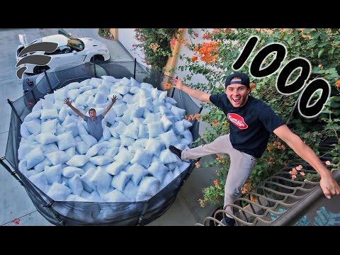 TRAMPOLINE FILLED WITH 1000 PILLOWS (COMPLETELY FULL)