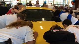 Kiss the Mustang the longest and win the car contest