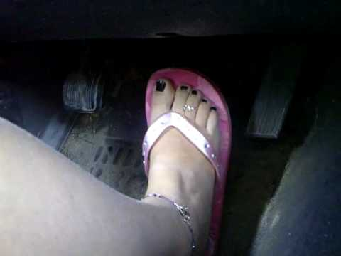 Driving Jeep in pink flip flops