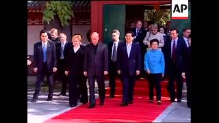 WRAP Russian President Putin arrives for visit to China, meets Hu