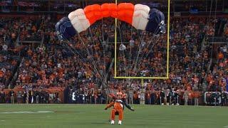 Denver Broncos parachute team fire up fans with risky stunts