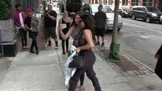 Kim Kardashian posing with a fan during the Fashion Week in New York