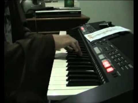 an amate7r s playing hijo de la luna piano voice cover.flv
