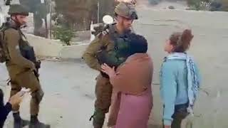 """Palestinian"" girls kick Israeli soldiers as provocation"