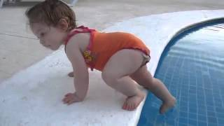 funny baby girl in Swimming Pool