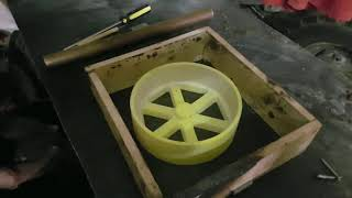 sand casting a pulley wheel.