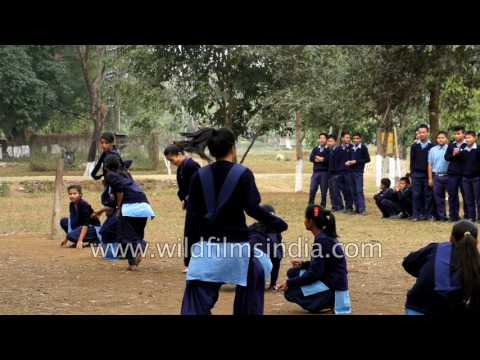 Indian School girls play, girl delivers karate kick - slow motion