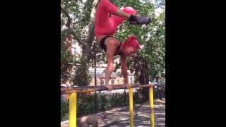 Acrobat Shows off Skills in Gym and World