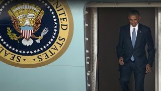 President Obama downplays China arrival incident