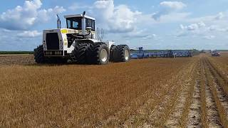 Big Bud 650-50 giving a 21 plow bottom salute.
