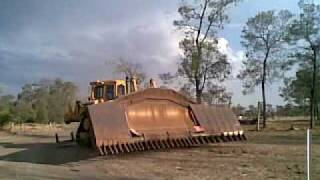 Caterpillar D8N Dozer with a 24ft clip on stickrake used for raking sticks and clearing