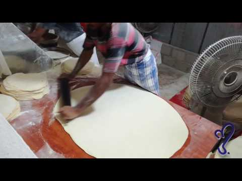 watch samosa and Vegetable Roll Covering Roti.