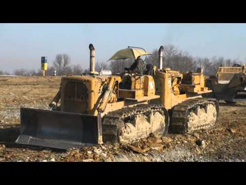 Caterpillar Dual D 9 s Pushing Scrapers 2