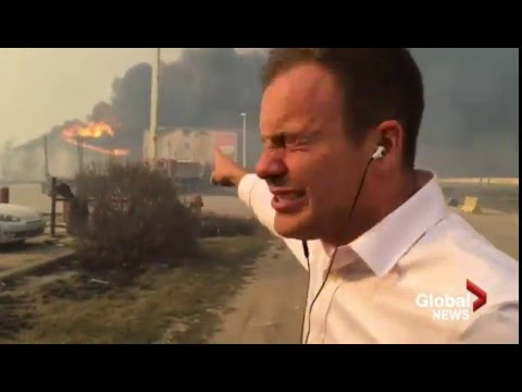 This is as bad as it gets Super 8 hotel burns behind Global News reporter during broadcast