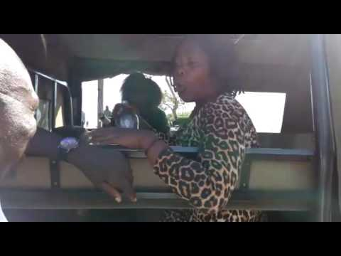 Drunk Kenyan woman Tells police officers to have sex with her and leave her!