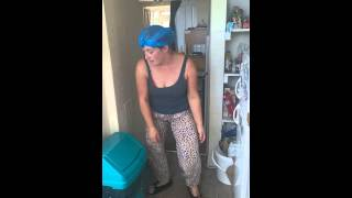 Parody of lady dancing with a broom to puerto rican song