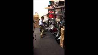 8 year old lifts Generator - Makinex Powered Hand Truck