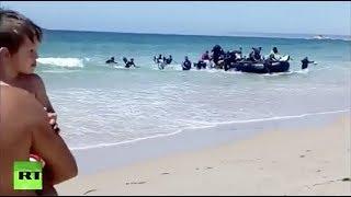 Boat with African migrants shocks sunbathers on Spanish beach