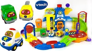 STORY WITH VTECH GO GO SMART WHEELS POLICE STATION PLAYSET EMERGENCY VEHICLES CARS AND SONGS