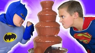 Batman vs Superman vs GIANT CHOCOLATE FOUNTAIN Battle! Spider-man Egg Hunt! + Candy + Surprise Funny