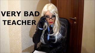 Bad teacher in leather jacket, leather skirt, leather gloves and thigh high boots