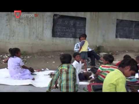Indian school under a rail bridge