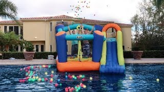THROWING GIANT BOUNCY HOUSE IN THE POOL!!! **DON