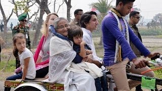 A Prime Minister visits her own village by rickshaw van and walking